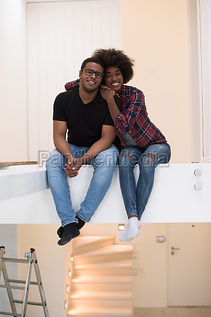 couple having break during moving to