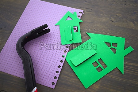 green cutouts of model houses with