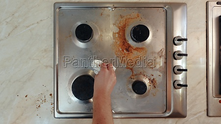 dirty stove in a kitchen cleaned