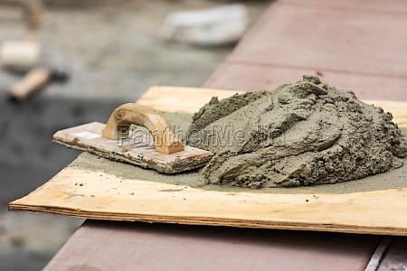wood float sitting near wet cement