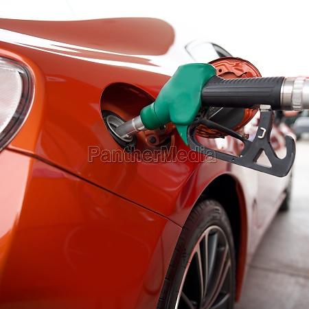 green benzene gas pump nozzle filling