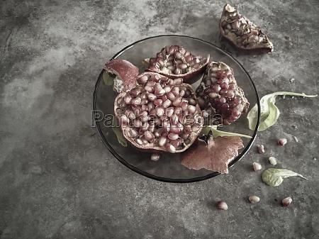 ripe juicy fruit pomegranate on the