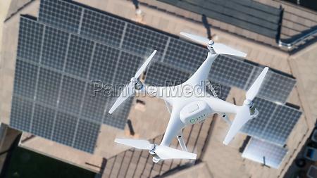 uav drone inspecting solar panels on