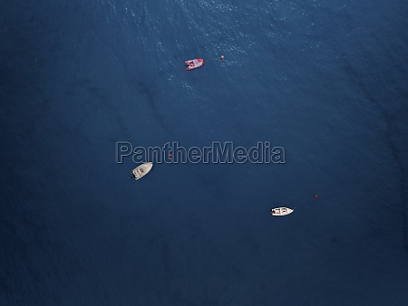 aerial view of three boats moored