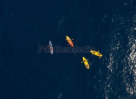 aerial view of people kayaking on