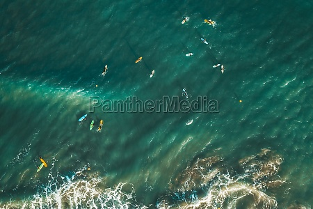 aerial view of people surfing the