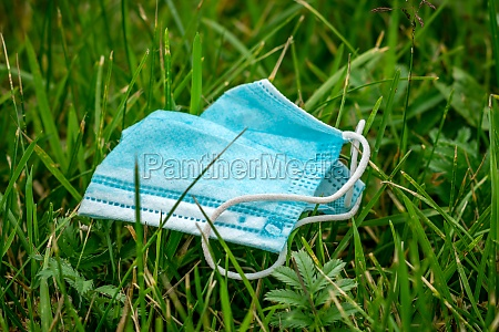 facial surgical mask used and thrown