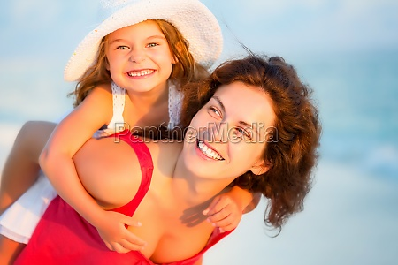 happy mother and daughter on the