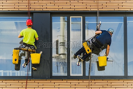 two men cleaning windows on an