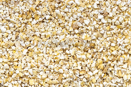 background uncooked crushed pot barley