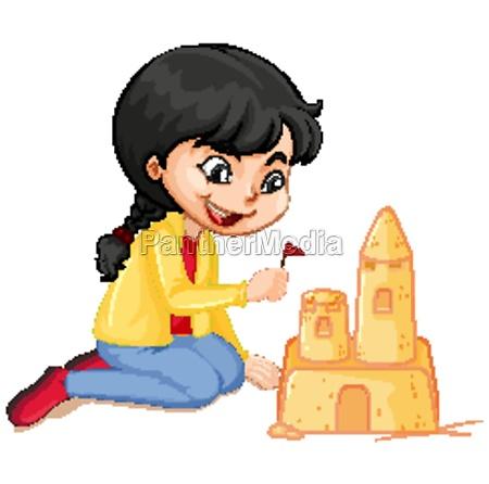 girl in yellow jacket making sandcastle