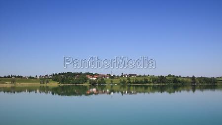 idyllic rural landscape reflecting in lake