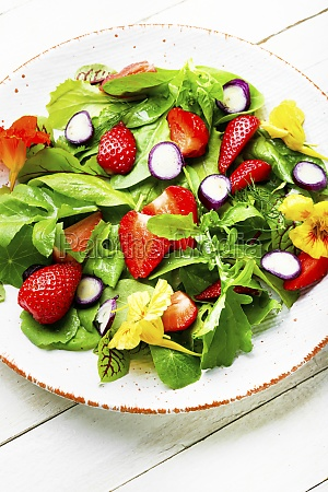 summer salad with berries and herbs