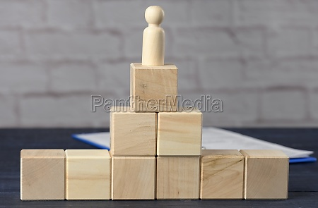 wooden figurine of a man on