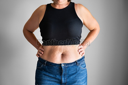 fat woman belly button and body