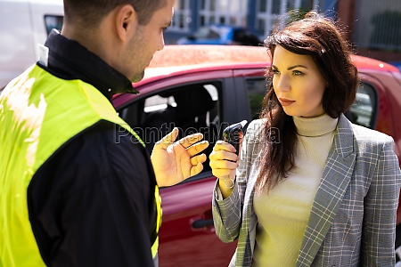 policeman doing driver alcohol test