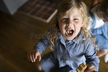 portrait girl showing food in mouth