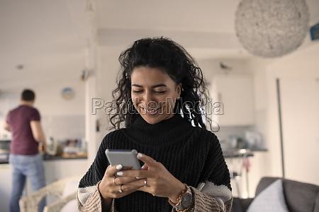 happy woman using smart phone at