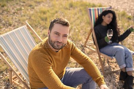 portrait confident man relaxing in lawn