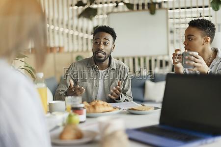 business people talking in breakfast meeting