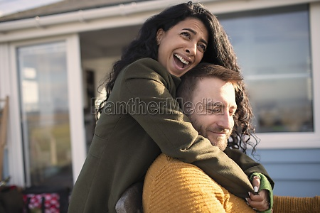 happy affectionate couple laughing and hugging