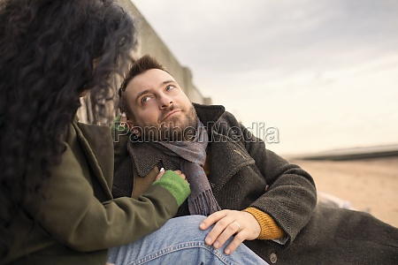 affectionate couple in winter coats on