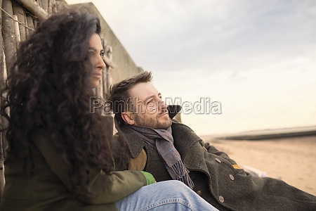serene couple in winter coat relaxing