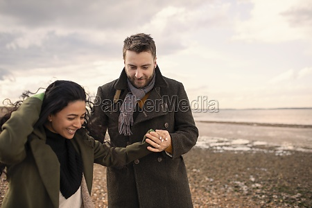happy couple in winter coats holding