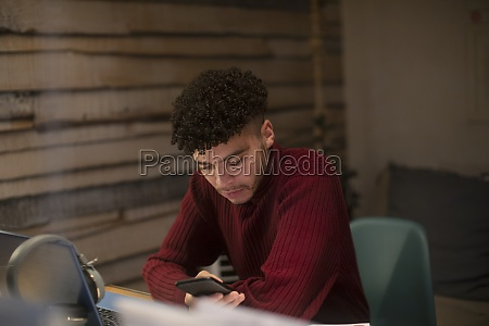 focused young man with smart phone