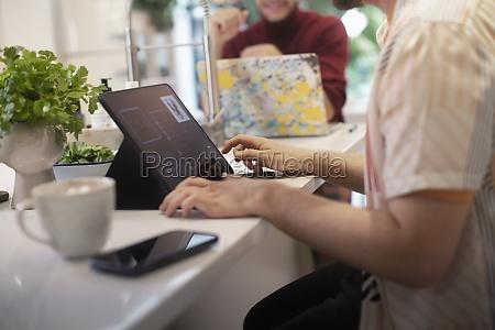 young man using digital tablet at