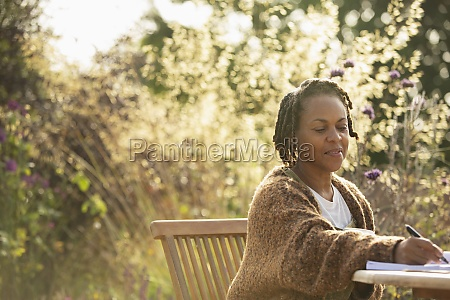woman working at table on garden
