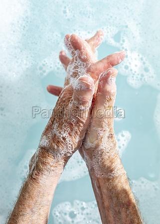 close up senior woman washing hands