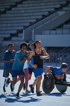 happy athletes on sunny sports track