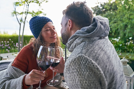 affectionate romantic couple drinking red wine