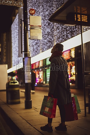 young woman with christmas shopping bags