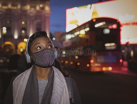 young woman in face mask with