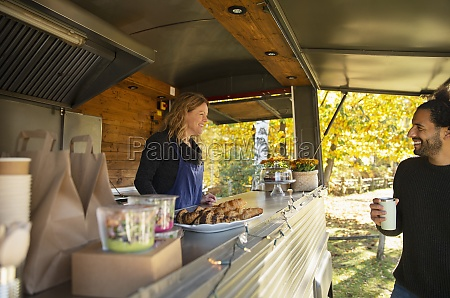 happy food cart owner talking with