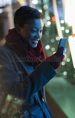young woman using smart phone on