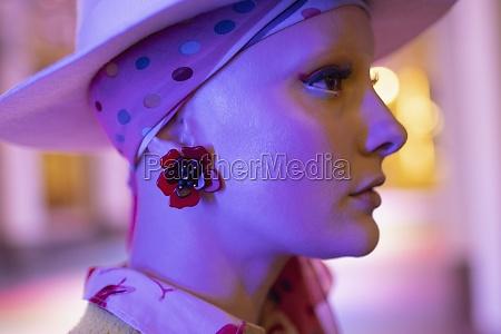 profile portrait fashionable woman with flower