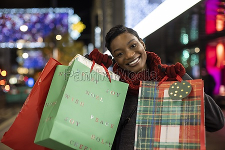 portrait happy young woman christmas shopping