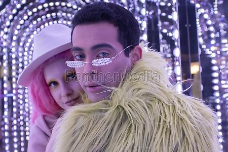 portrait cool fashionable couple under arch