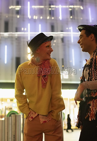 happy couple talking below modern city