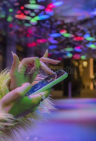 close up woman using smart phone