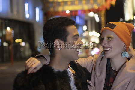 happy stylish couple on city street