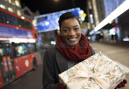 portrait young woman with christmas gift