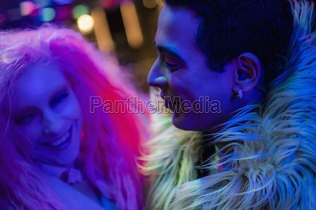 happy stylish couple laughing