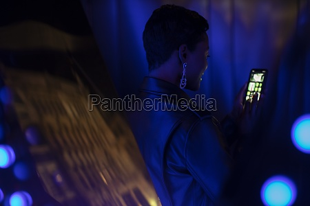 young woman using smart phone in