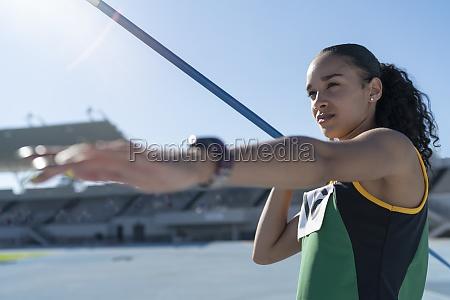 focused female track and field athlete