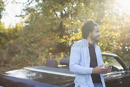 young man with smart phone at