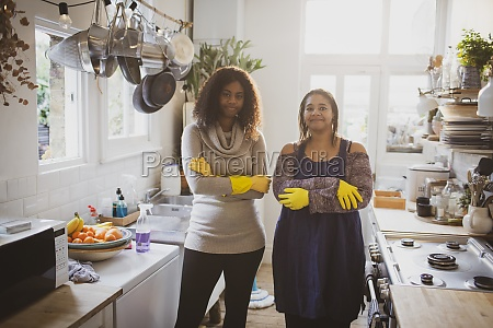 portrait confident mother and daughter cleaning